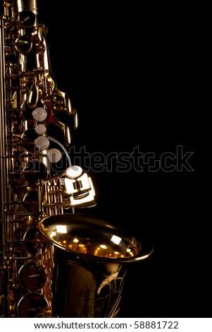 Lateral take of a golden alto saxophone - stock photo