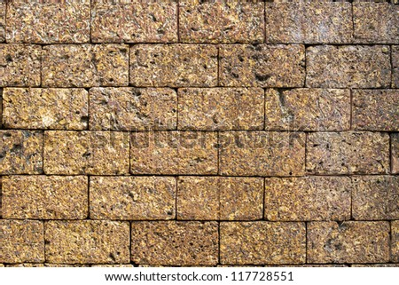 Laterite stone brick wall. - stock photo