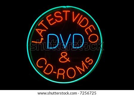 Latest Video, DVD, & CD-ROMS neon sign on black - stock photo