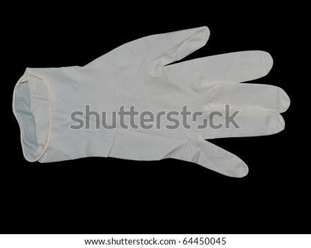 Latex Surgical gloves isolated on black background - stock photo