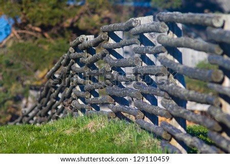 Lath fence, focus in the middle - stock photo