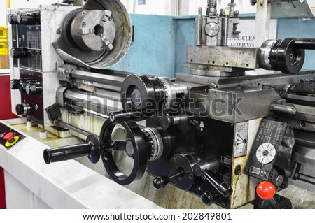 lathe machine in a workshop, Part of the lathe - stock photo
