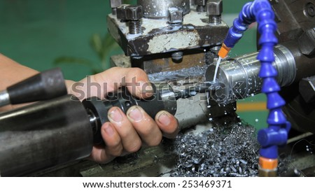 lathe machine in a workshop, Part of the lathe. Lathe machine is operation on the work shop ,Workpiece punching on the lathe - stock photo