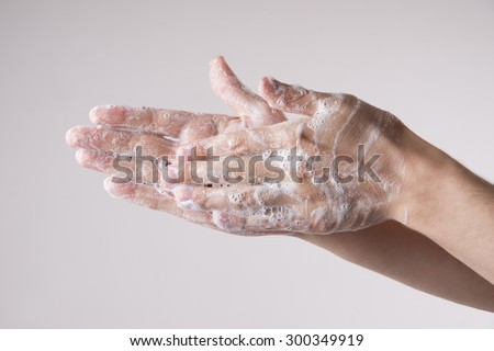 Lathered men's hands. Personal hygiene, cleansing the hands. - stock photo