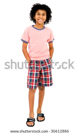 Latin American boy standing and smiling isolated over white