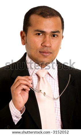 Latin American business man portrait with a pair of glasses on his hand