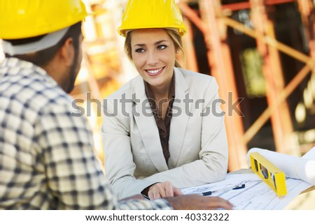 latin american construction worker and female architect talking. Copy space - stock photo