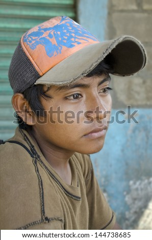 Latin american teen Great glance portrait from a young boy in the southern border of Mexico - stock photo