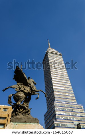 Latin American Tower, first skyscraper in Mexico City and statue - stock photo