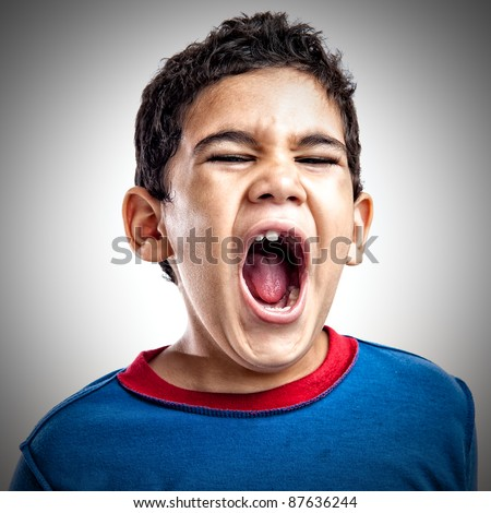 Latin boy screaming with anger - stock photo