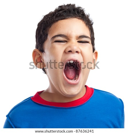 Latin boy screaming with anger on a white background - stock photo