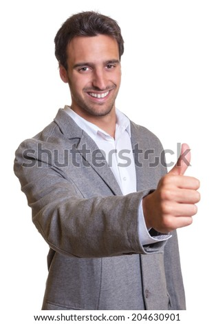 Latin businessman in grey suit showing thumb up  - stock photo