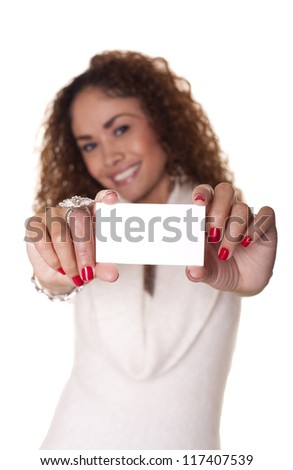 Latin businesswoman holds out a blank business card isolated on white background.