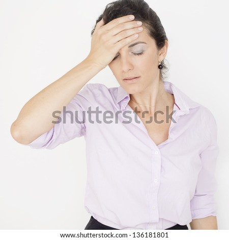 Latin businesswoman suffering from headache