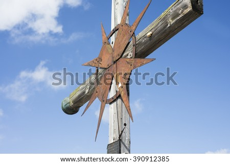 Latin cross against the sky on the summit of Mount Guffert in the European Alps, Rofan mountains, Tirol, Austria - stock photo