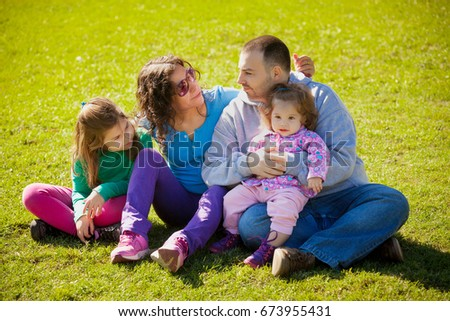 latin family in summer park