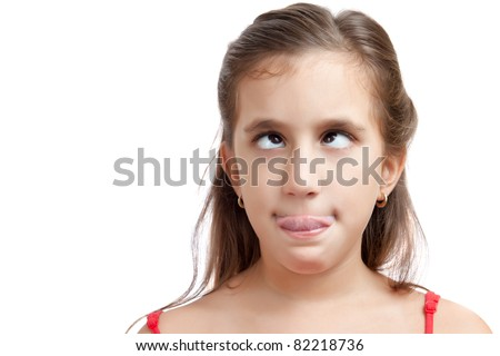 Latin girl with a silly expression and cross-eyed look isolated on a white background - stock photo