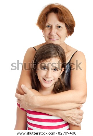 Latin grandmother hugging her granddaughter isolated on a white background