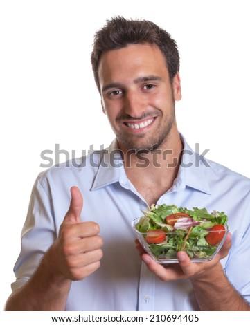 Latin man recommending fresh salad  - stock photo