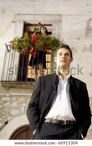Latin man with her girlfriend on a balcony