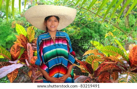 Latin mexican hispanic woman with sombrero and poncho in rainforest jungle [Photo Illustration]