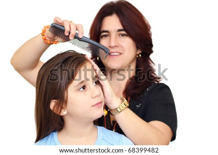 Latin mother combing her beautiful daughter hair isolated on a white background - stock photo