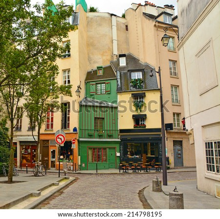 Latin Quarter of Paris. Narrow cobbled street among old traditional parisian houses in Paris, France - stock photo
