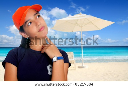 Latin teen girl hispanic ethnicity pensive girl with orange cap in Caribbean beach [Photo Illustration] - stock photo