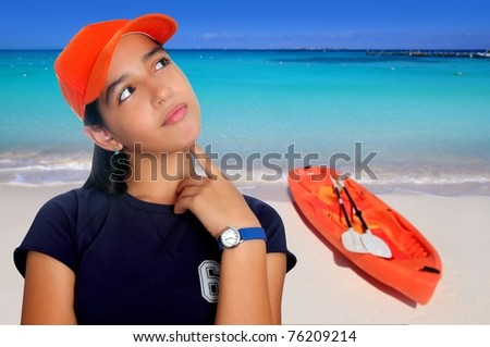 Latin teen hispanic pensive girl orange cap in Caribbean beach kayak [Photo Illustration] - stock photo