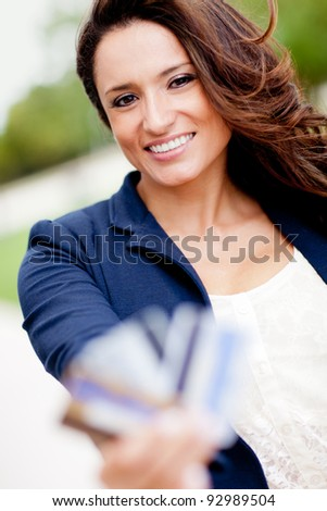 Latin woman holding credit cards - financial solutions - stock photo