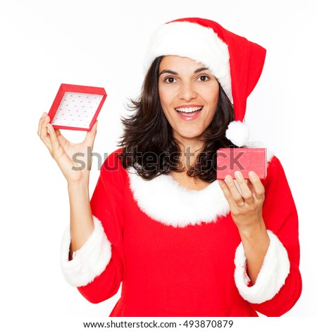 Latin woman in red christmas dress with a gift