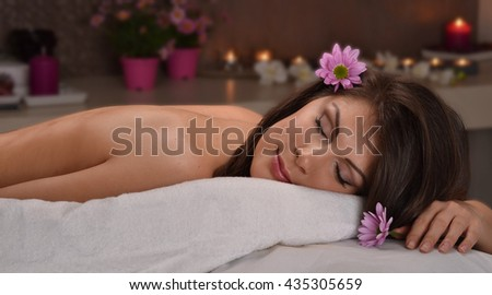Latin woman resting after massage at beauty center and spa - stock photo