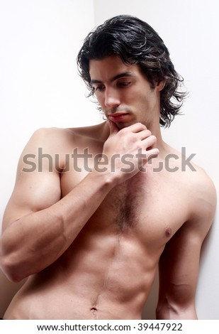Latin young man without a vest on a light background. - stock photo