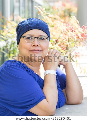 Latina Female Breast Cancer Patient Wearing Medical Wrist Band - stock photo