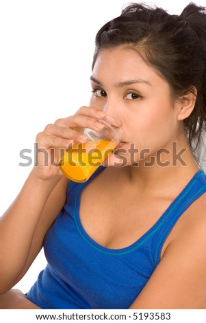 Latina girl drinking orange juice from glass - stock photo