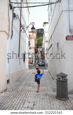 LATINA, ITALY - AUGUST 9, 2014: Children play soccer in the old town of San Felice Circeo - stock photo