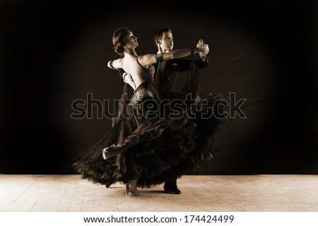Latino dancers in ballroom isolated on black - stock photo