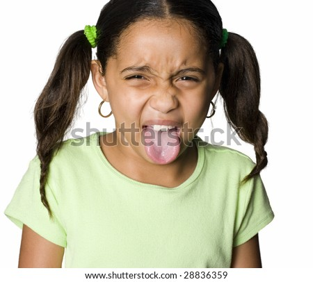Latino girl sticking out tongue - stock photo
