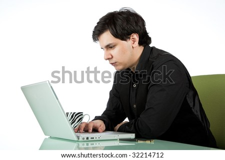Latino man working at a laptop computer isolated on white