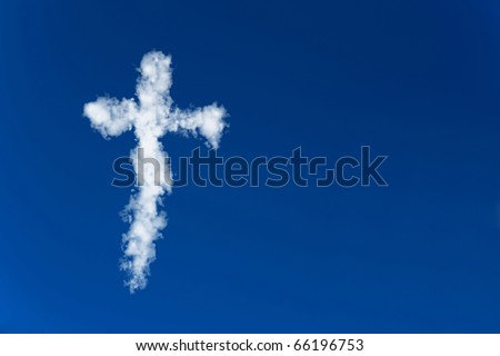 Lation cross made of clouds in a blue sky - stock photo