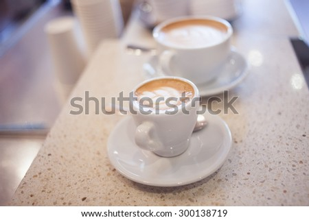 latte art by barista focus in milk and coffee,  vintage color  - stock photo
