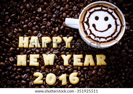 "latte art coffee and alphabet "" happy new year 2016"" made from bread cookies on coffee beans background - stock photo"