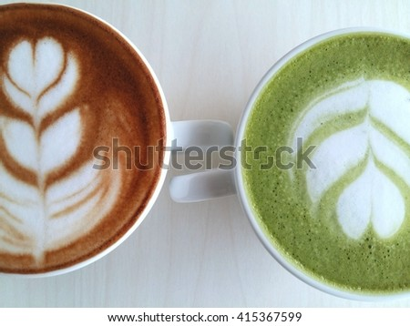 Latte art coffee and matcha latte so delicious on table background - stock photo