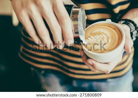 Latte art coffee cup - vintage effect - stock photo