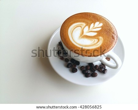 Latte art coffee so delicious isolated on white background