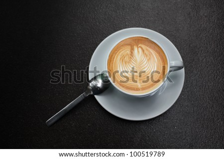 latte art in white cup. - stock photo