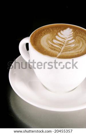 Latte Art on a Cappucinno - stock photo