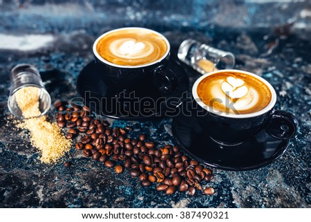 Latte art on espresso coffee. Black coffee served in bar - stock photo