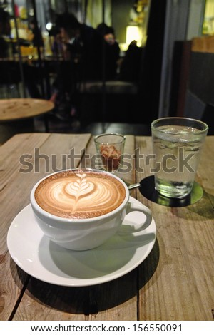 Latte art with tulip flower - stock photo