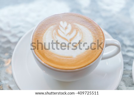 Latte Coffee art on the table - stock photo